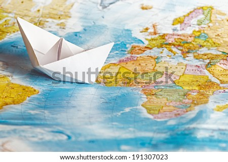 ship from a paper on the geographical map background - stock photo
