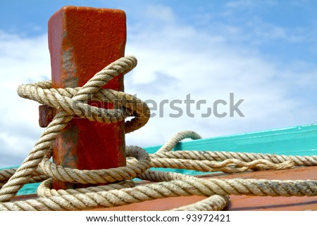 Ship hemp cable bound over a mooring bollard - stock photo
