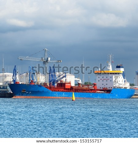 Ship in cargo port fuel terminal. Ventspils terminal, Latvia - stock photo