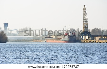 Ship in cargo port terminal. Riga terminal, Latvia - stock photo