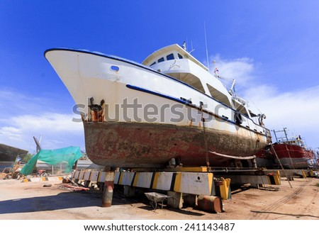 Ship in dry dock during the overhaul.  - stock photo