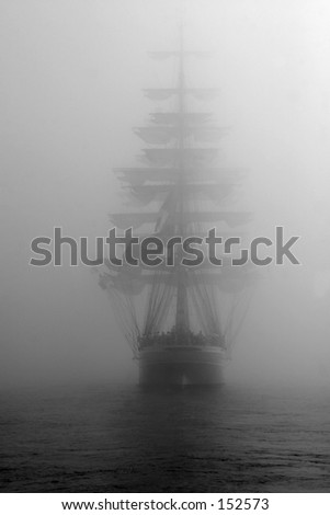 Ship in fog. Black and white photo. - stock photo