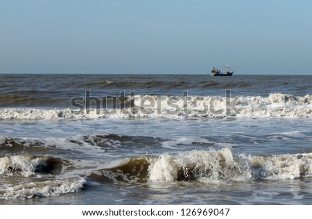 Ship in wild sea - stock photo