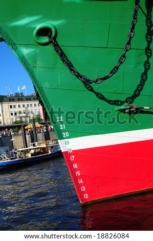 Ship lies at anchor in port - stock photo