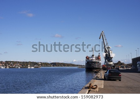 Ship loader scrap in harbor - stock photo
