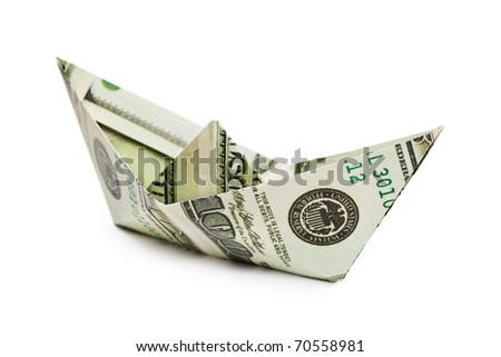 Ship made of money isolated on white background - stock photo
