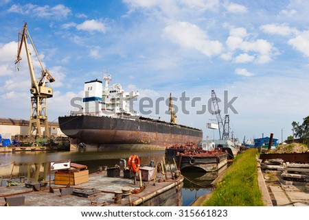 Ship moored at the quay in shipyard of Gdansk, Poland. - stock photo
