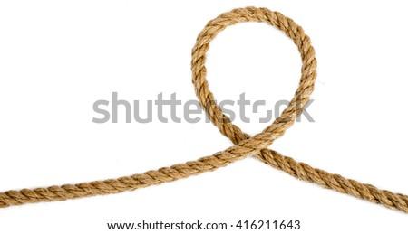Ship rope isolated on white background, closeup - stock photo