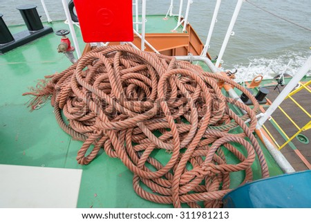 Ship ropes heap. Pile of various ropes and strings - stock photo