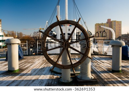 ship steering wheel in the afternoon - stock photo