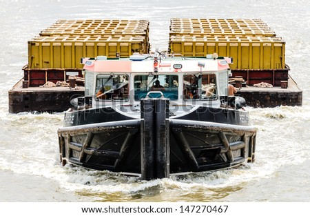 Ship towing big yellow boxes - stock photo