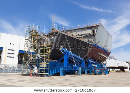 Ship under construction in a modern shipyard - stock photo