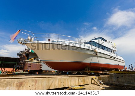 Ship waiting for repairs on a dry dock  - stock photo