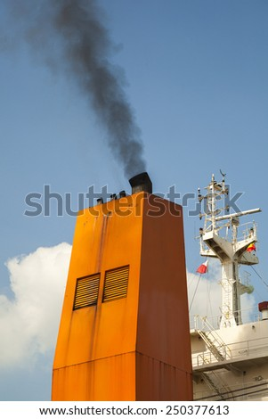 ship with smoke emission and air pollution - stock photo