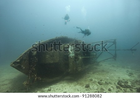 Ship wreck diving with two divers in Madagascar - stock photo