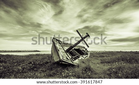 Ship wreck lay near by a sea at Rayong, Thailand in monochrome color - stock photo