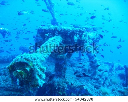 Ship wreck underwater with fishes - stock photo