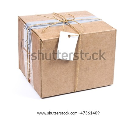 Shipping  box with tag - stock photo
