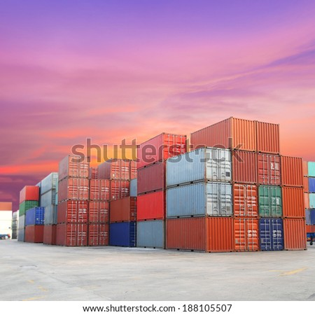 Shipping containers at the docks with beautiful sky - stock photo