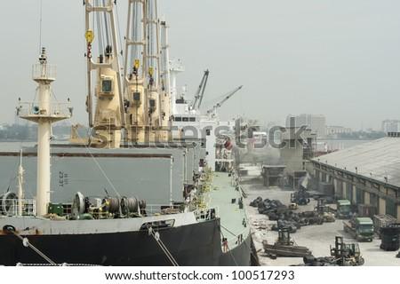 Ships cargo on dock - stock photo