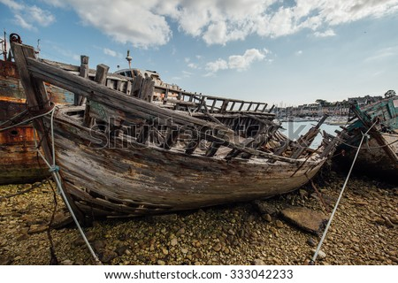 ships graveyard, old shipwreck in harbor of camaret, brittany, france - maritime heritage trail port - stock photo