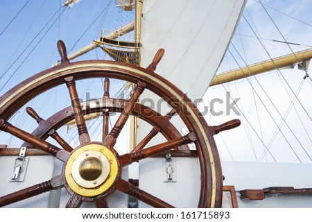 Ships helm on deck of a clipper ship, Italy - stock photo
