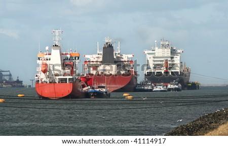 Ships in Rotterdam harbor - stock photo