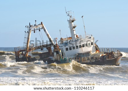 Shipwreck along the Skeleton Coast of Namibia - stock photo
