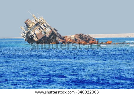 Shipwreck near the island of Tiran - attraction of the resort of Sharm - El - Sheikh. Egypt, Red Sea. - stock photo