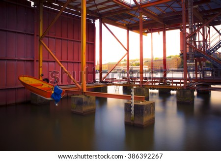 Shipyard with long exposure - stock photo
