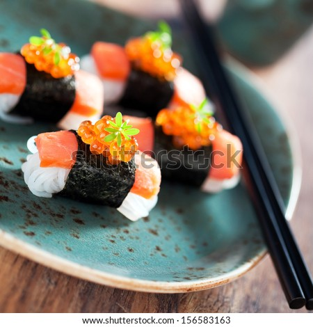 Shirataki sushi with salmon and caviar, selective focus - stock photo