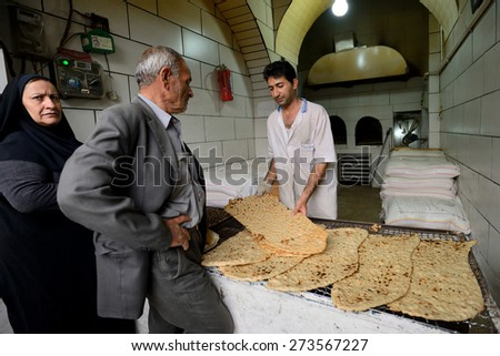 SHIRAZ - APRIL 15: Unknown people trades bread in market (Vakil Bazaar) in Shiraz, Iran on April 15, 2015. Vakil Bazaar is the most important tourist attraction in Shiraz, Iran. - stock photo