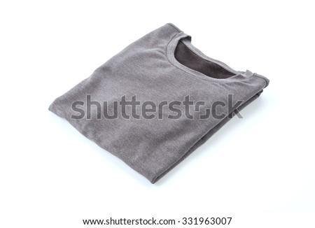 shirt. folded t-shirt on white background - stock photo
