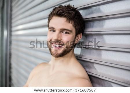 Shirtless fit man posing at crossfit gym - stock photo