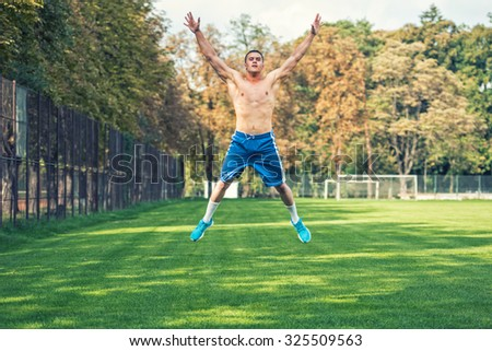 Shirtless handsome man working out in park, cross fit training. Athletic man jumping and doing exercises outdoor, on a summer day. - stock photo