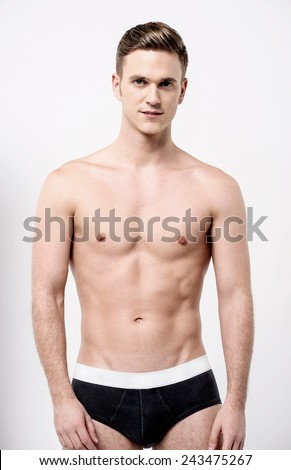 Shirtless male model in black underwear  - stock photo