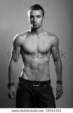 Shirtless male model in studio - stock photo