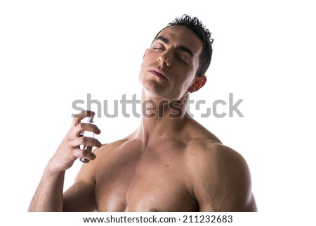 Shirtless male model spraying cologne on white background, eyes closed - stock photo