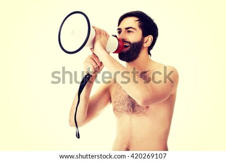 Shirtless man shouting using a megaphone. - stock photo