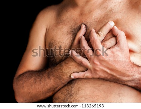 Shirtless man suffering a heart attack and grabbing his chest - stock photo