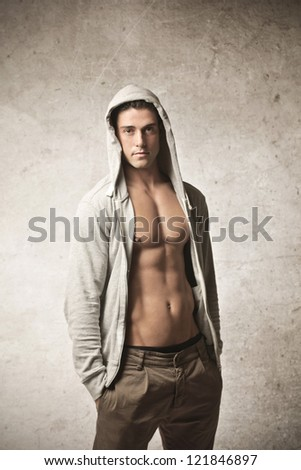 Shirtless man with hands in pockets - stock photo