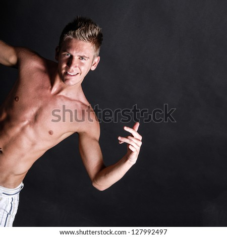Shirtless model on black background - stock photo