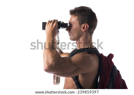 Shirtless muscular young man with binocular and backpack on his back, isolated on white - stock photo