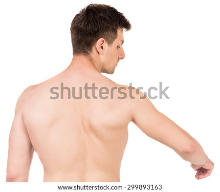 Shirtless young man suffering from shoulder pain on white background. - stock photo
