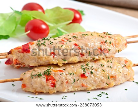 shish kebab of chicken with peppers and cheese - stock photo