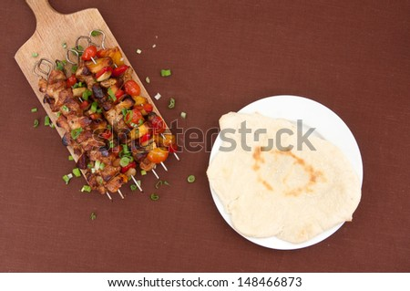 shish kebab on skewers and pita bread - stock photo