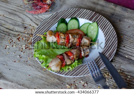 shish kebab plate with knife and fork on the wooden table - stock photo