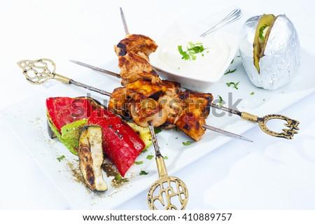 Shish taouk - Chicken shish kebab on white platter. Lebanese chicken - stock photo