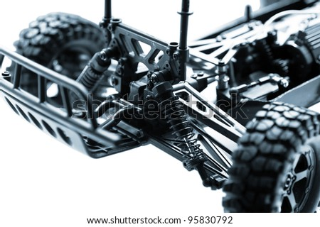 shock absorber with spring and other details of a suspension of the toy machine - stock photo