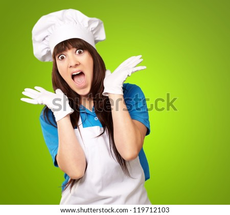 Shock To Woman On Cooking Time On Green Background - stock photo